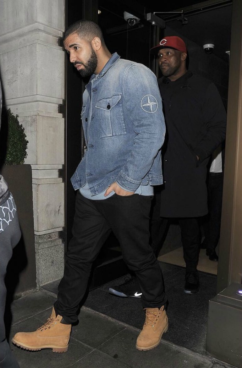 A denim jacket and black jeans paired with Timbs are an ideal winter pairing.