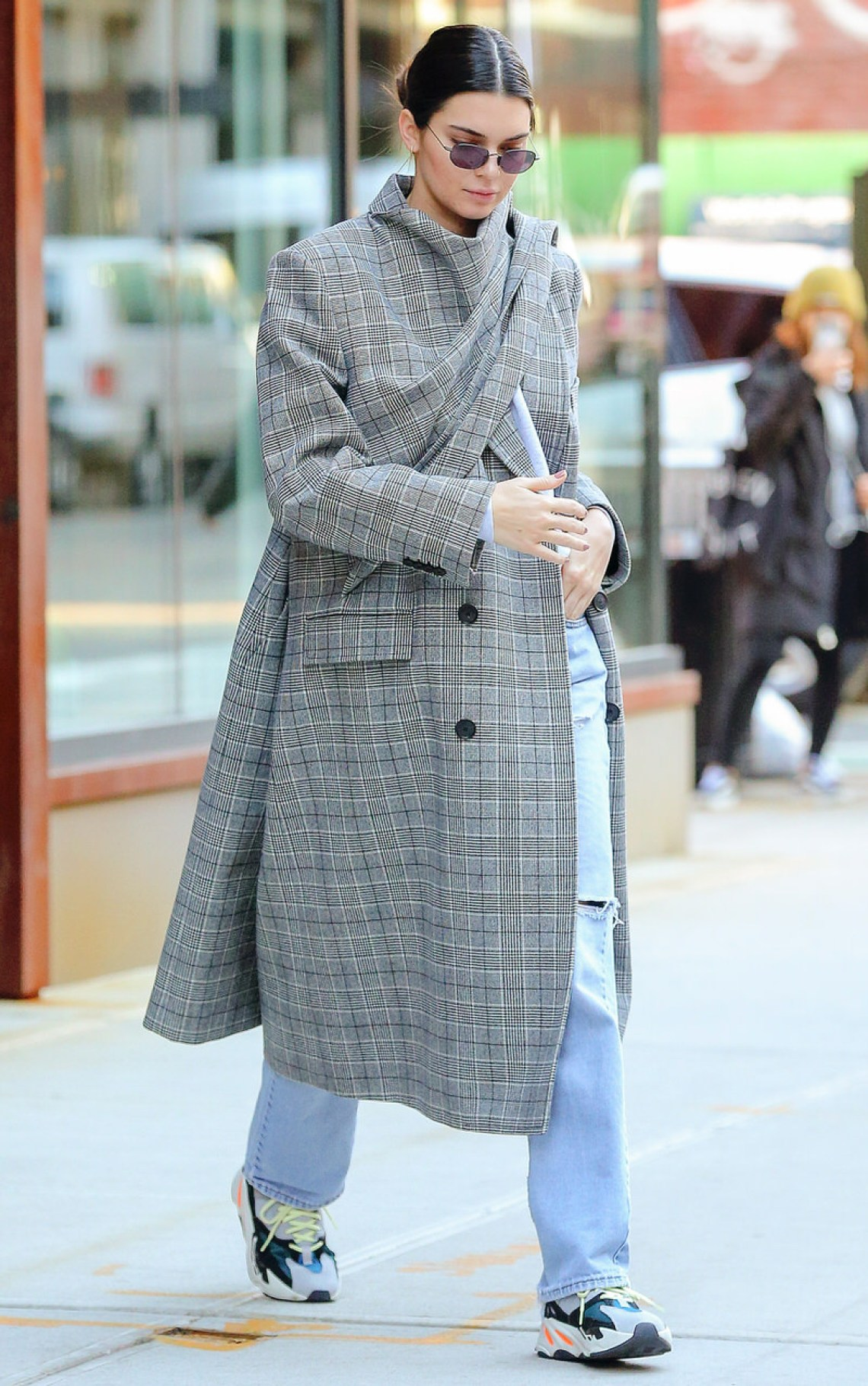 Kendall Jenner wears Balenciaga coat with Yeezy 700's.