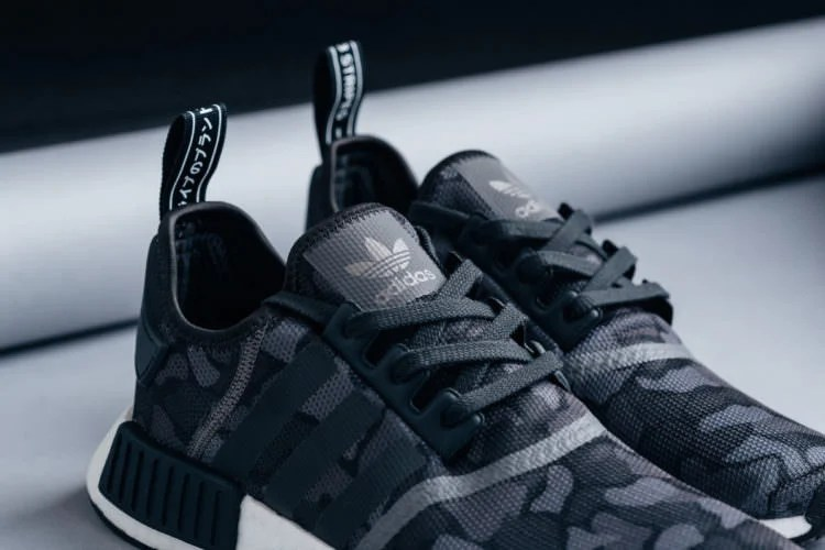"separation shoes 122a5 7ed9e Available now, the adidas NMD R1 ""Duck CamoCore Black"" can be copped from  Feature for 130."