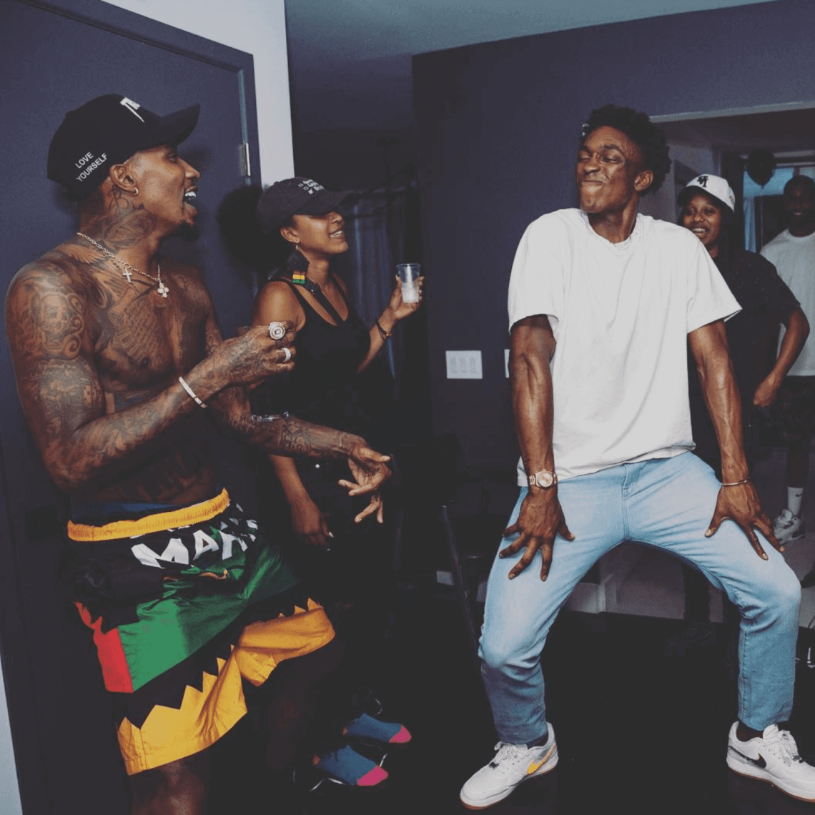 a0845efa9c6d43 Soulja Boy in the adidas Yeezy Boost 700 Wave Runner Stanley Johnson in the  Nike Air Force 1 Low