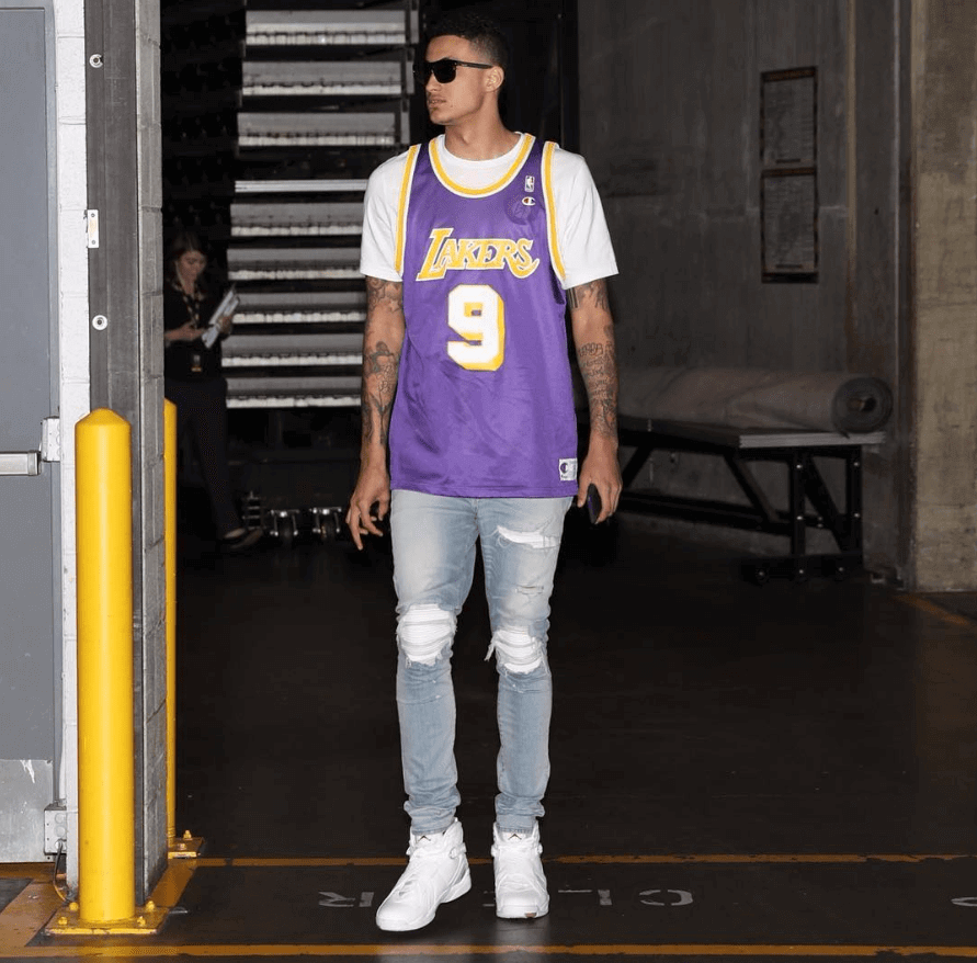 Inspired by different Jumpman icons. Kuzma wears OVO Jordan 8s, AMIRI MX-1 jeans, and a retro Lakers jersey.