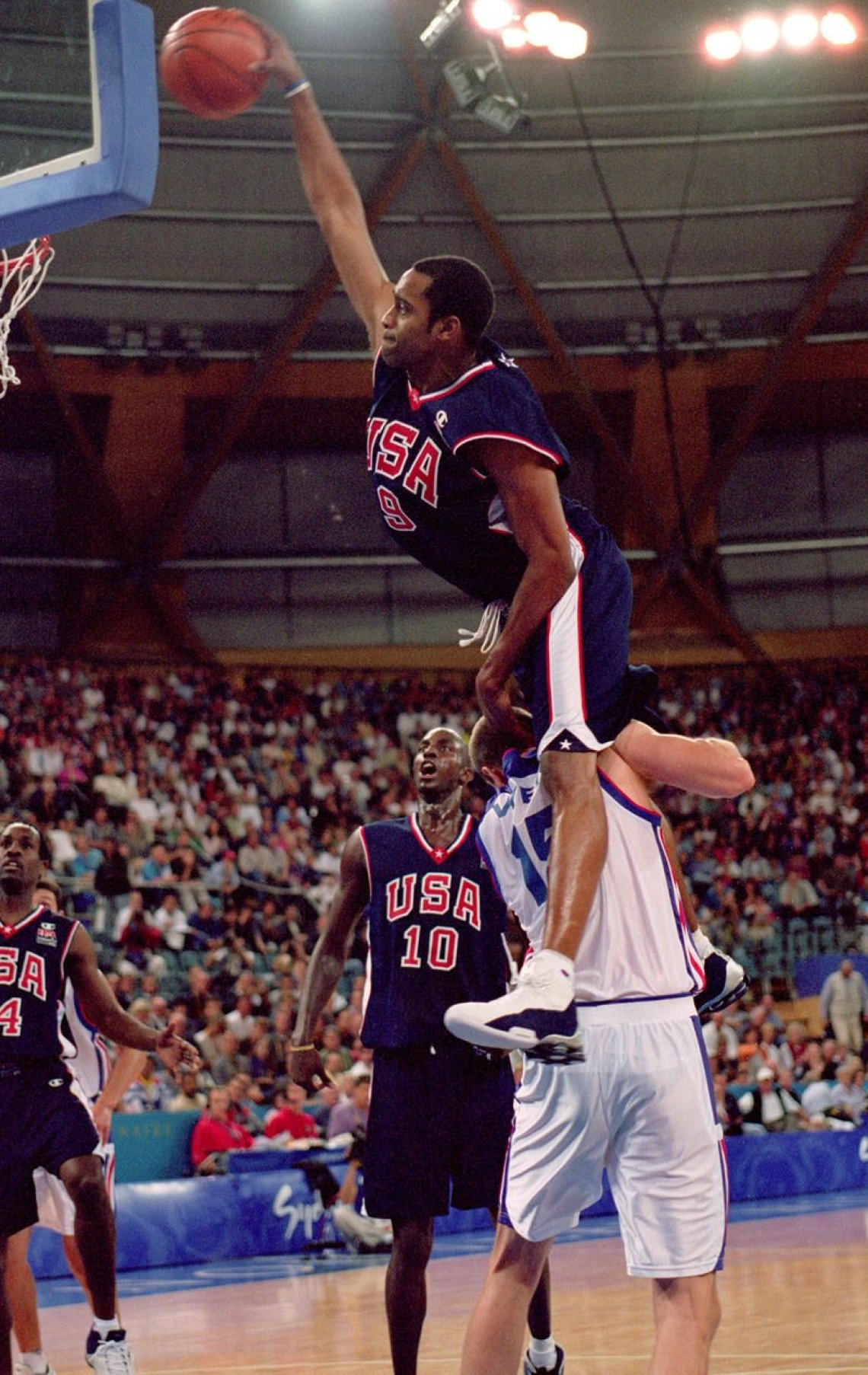 "aadcad2e21a Vince Carter in the Nike Shox BB4 during the ""Dunk of Death"" in 2000 Summer  Olympics (photo by Darren McNamara/Allsport)"