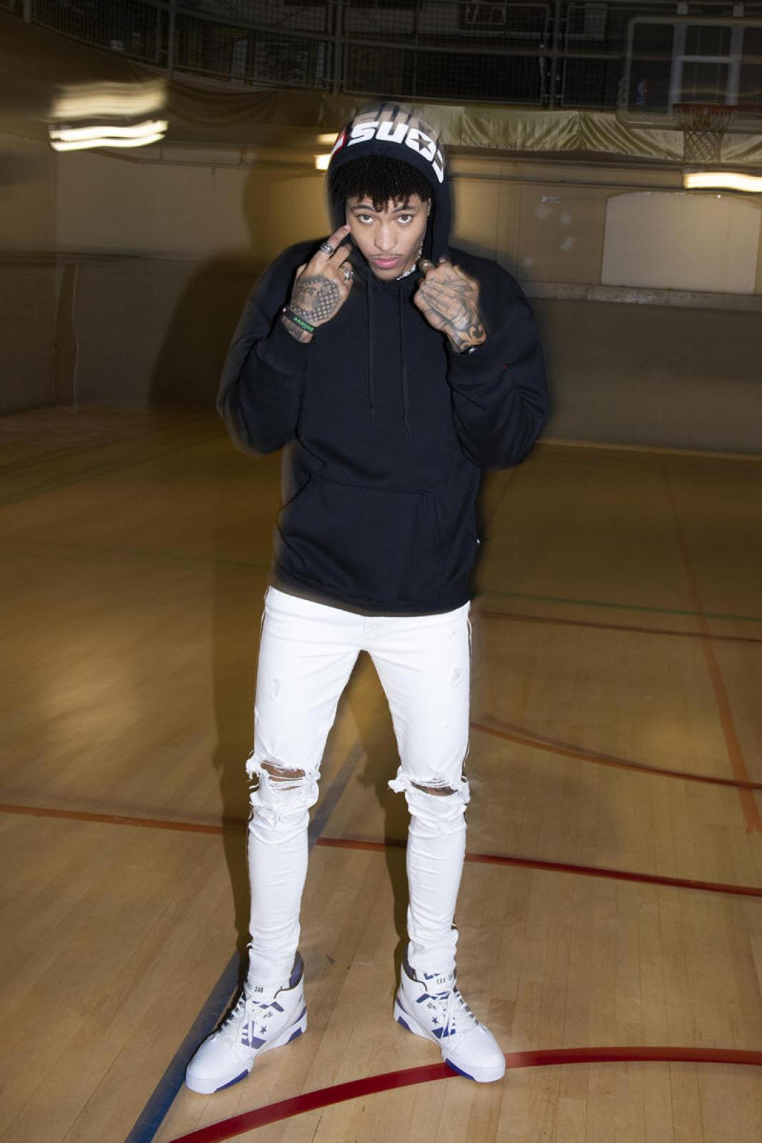 The style guides will tell you to make room for looser fitting pants and denim in your wardrobe. The NBA player on the other hand will show you that ripped skinny jeans and basic hoodies are still the move.