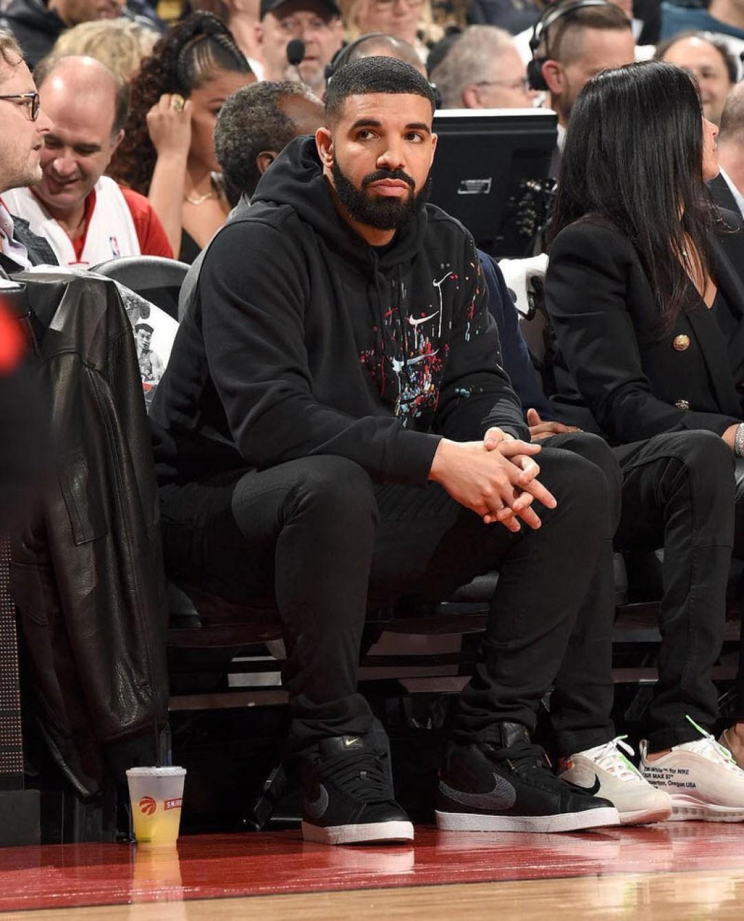 Drake wears graphic Nike sweatshirt and skinny jeans with the Supreme x Nike SB Blazer (photo by Ron Turenne).