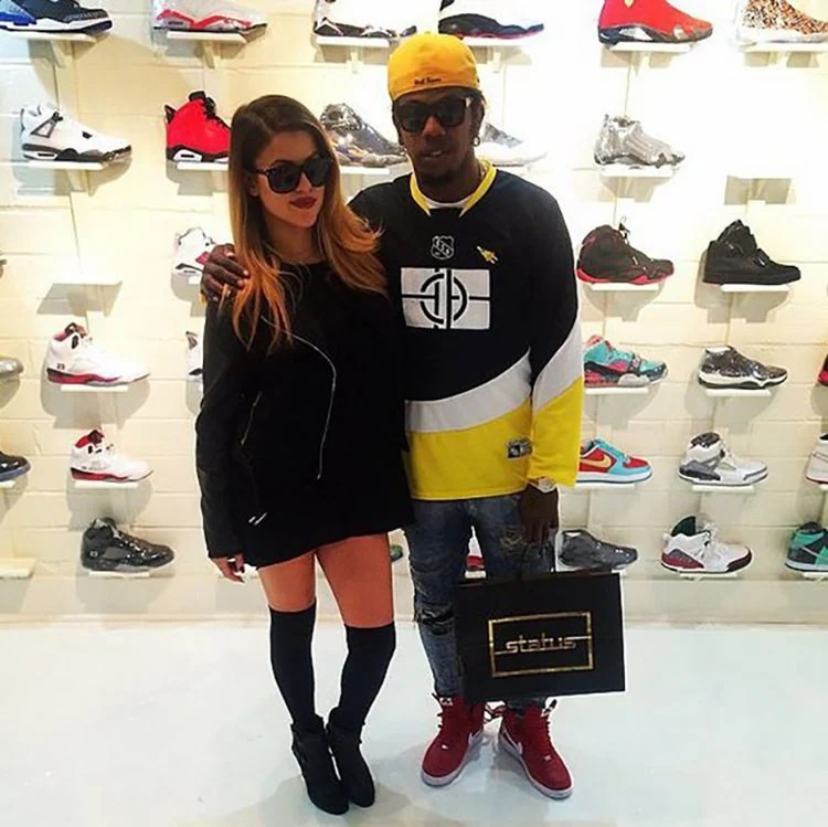 Trinidad James teams a hockey jersey with thrashed jeans and a hockey jersey with his Supreme x Nike Air Force 1 Highs.