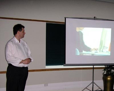 Nicholas watching one of the Advertisements during the presentation