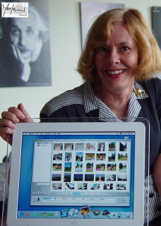 Close-up of Susan with iMac showing iPhoto