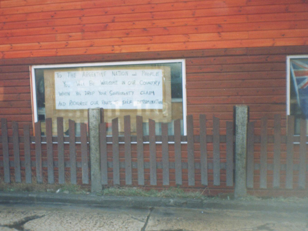 Sign in shop window at Port Stanley