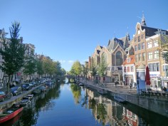View from bridge by Cafe Emmelot with Oude Kerk (Old Church) on the right, Amsterdam's oldest building.