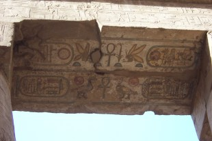 Coloured Hieroglyphics still remain on ceiling points of Karnak Temple.