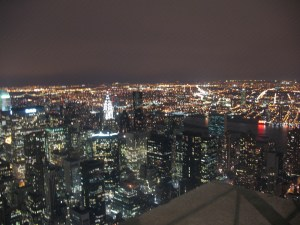 View from Empire State Building with Chrysler building lit up near centre