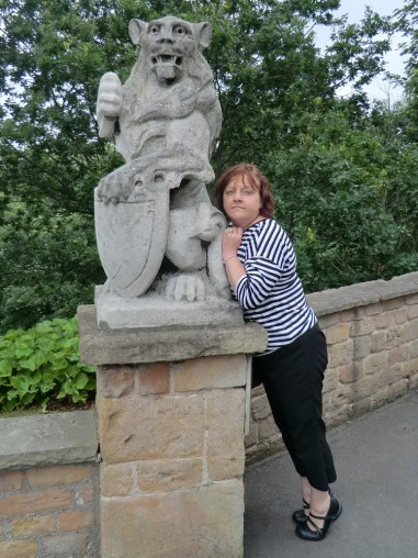 Sam and gargoyle outside at the top of the stairs of Nottingham Castle ducal mansion.