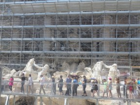 The Trevi Fountain hidden behind plexi-glass and scaffolding.