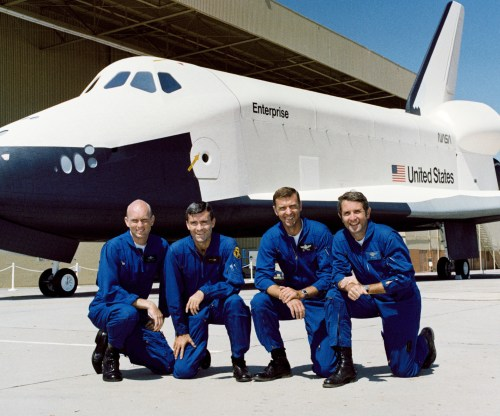 (L-R) Gordon Fullerton, Fred Haise, Joe Engle and Richard Truly pose in front of the prototype orbiter Enterprise