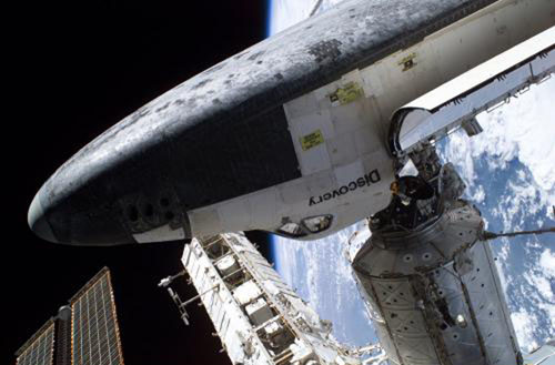 Space Shuttle Discovery docked to the Destiny laboratory of the ISS.