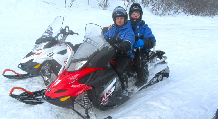 Nick Cook and Sam Cook on snowmobile safari at Kirkenes