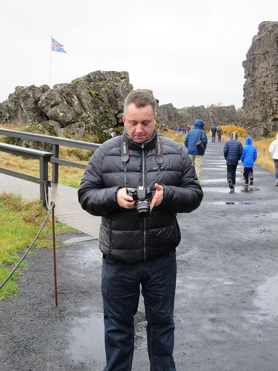 Examining a rain soaked DSLR at the Thingvellir Icelandic Parliament