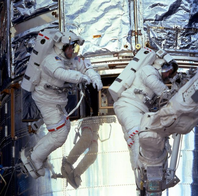 Astronauts Michael Foale (left) and Claude Nicollier during EVA 2 Hubble Service Mission on STS103