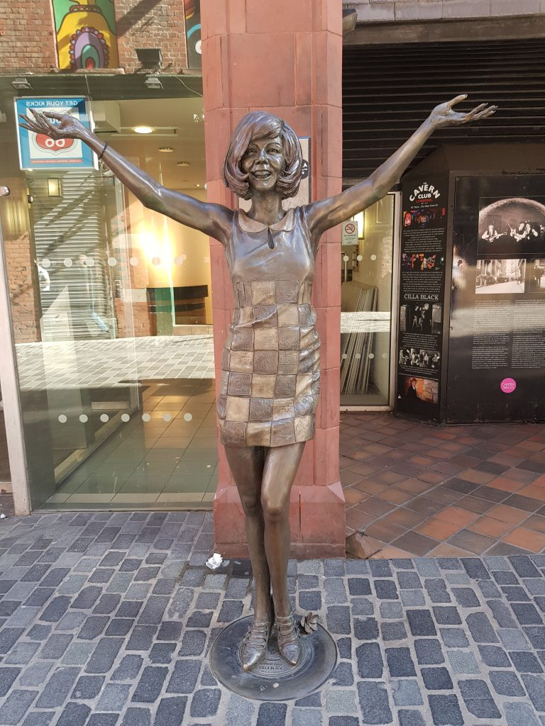 Surprise, surprise, Cilla Black welcomes us to Liverpool with open arms