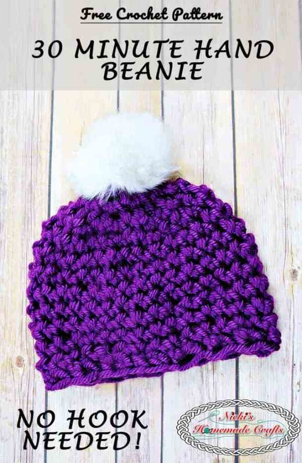 30 Minute Hand Beanie is made with your hands in a purple or red yarn and features as faux fur pom-pom on top - by Nicki's Homemade Crafts - Free Crochet Pattern This beanie is made with simply one skein of yarn and your hands. No crochet hook is needed. It comes with a full video tutorial as well. #freecrochetpattern #crochet #beanie #hat #quick #easy