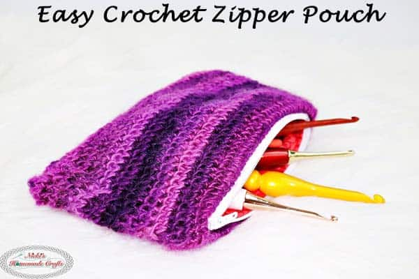Easy Crochet Zipper Pouch as a free crochet pattern includes some diy sewing parts showing off crochet hooks inside as storage