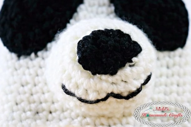 Panda Bear Tissue Box Cover which is a Free Crochet Pattern by Nicki's Homemade Crafts featuring the eyes and nose of the panda bear
