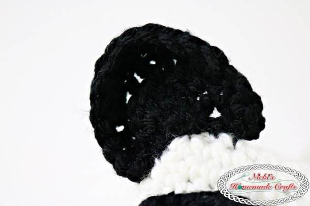 Panda Bear Tissue Box Cover which is a Free Crochet Pattern by Nicki's Homemade Crafts featuring the ear of the panda bear