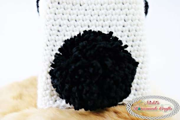 Panda Bear Tissue Box Cover which is a Free Crochet Pattern by Nicki's Homemade Crafts featuring the back of it showing of the pom-pom tail