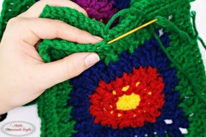 Granny's Flower Garden Blanket is a free crochet pattern that is broken up into a parts for a Crochet Along, blanket, crochet flowers, flowers, garden, colorful blanket, flower blanket, yellow border