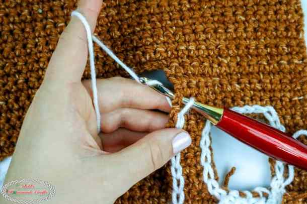 surface crochet as snow for gingerbread house