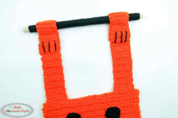 arms as handles for pumpkin trick or treat bag