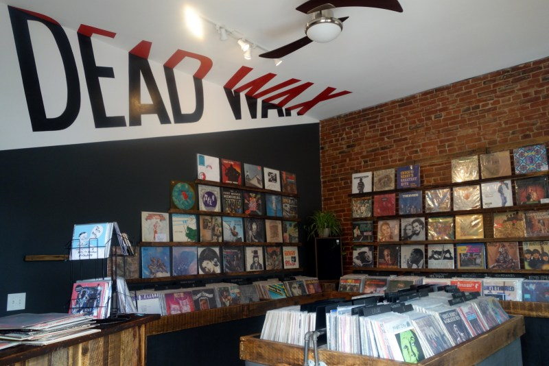 Loving the ceiling logo split-painting at Dead Wax Records on Cherokee Street