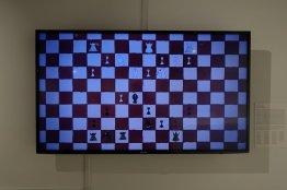 Robot Chess, 1. d4 Nf6 2. Nf3 b6 3. c4 e6 4. Bg5 Be7 5. Nc3 Bb7 6. Qc2 d5 7. e3 O-O 8. cd5 Nd5 9. Be7 Qe7 10. Nd5 Bd5 11. Bd3 h6 12. a3 c5 13. dc5 Rc8 14. b4 bc5 15. Rc1 Nd7 16. Ba6 Rc7 17. e4 Bb7 18. Bb7 Rb7 19. bc5 Qc5 20. O-O Qc2 21. Rc2 Kf8 22. Rfc1 Ke7 23. Nd4 Ke8 24. f4 Rab8 25. e5 Nf8 26. Rc5 Rb1 27. Rb1 Rb1 28. Kf2 Rb7 29. Rc8 Ke7 30. Ra8 Ng6 31. g3 Kd7 32. a4 Ne7 33. Nb5 Nc8 34. g4 Rb5 35. ab5 Kc7 36. g5 hg5 37. b6 Kb7 38. Rc8 Kc8