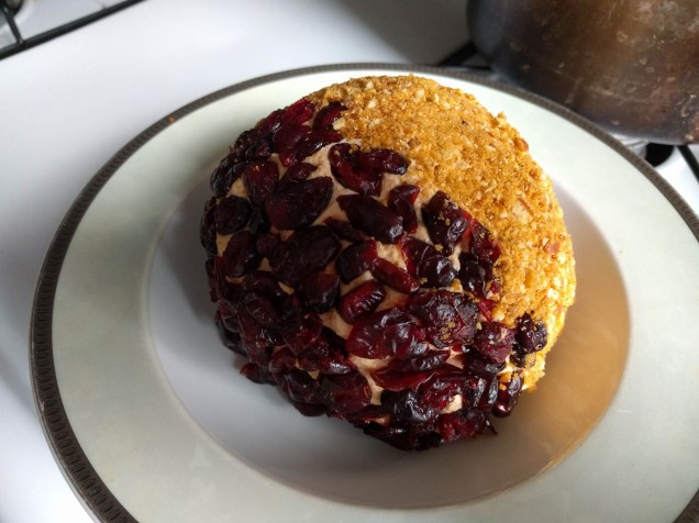 cranberries and crushed jalapeño pretzel shell, around cheeseball with maple syrup & picante hot sauce - it was amazing!