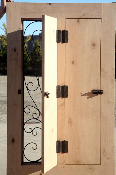 Exterior Rustic Door With Wrought Iron Venting Grills
