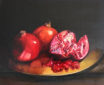 Pomegranates on a gold plate