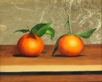 Satsumas on gold leaf