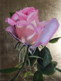 Sunlit rose on gold