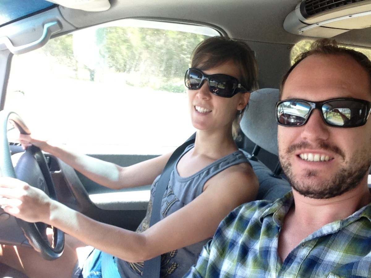 A selfie of us driving in our campervan in Australia