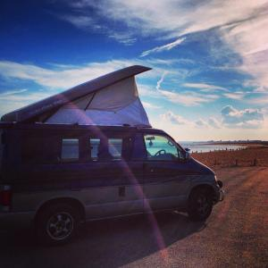 Our Mazda Bongo camper van parked up on the beach