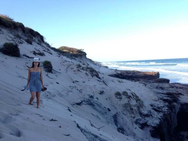 Climbing down the huge sand dunes at Ten Mile Beach, Australia
