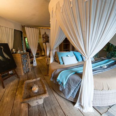 An interior shot of the bed in our tent at Sandat Glamping Resort, Ubud.