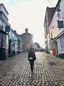 An image of me strolling on the cobbles in Lymington