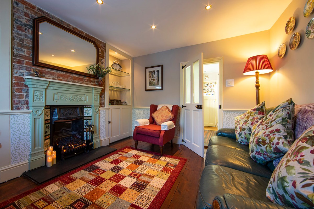The lounge in The Snug, featuring a cosy fireplace