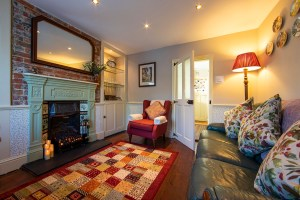 The lounge in The Snug, featuring a cosy fireplace. Unique places to stay in the UK
