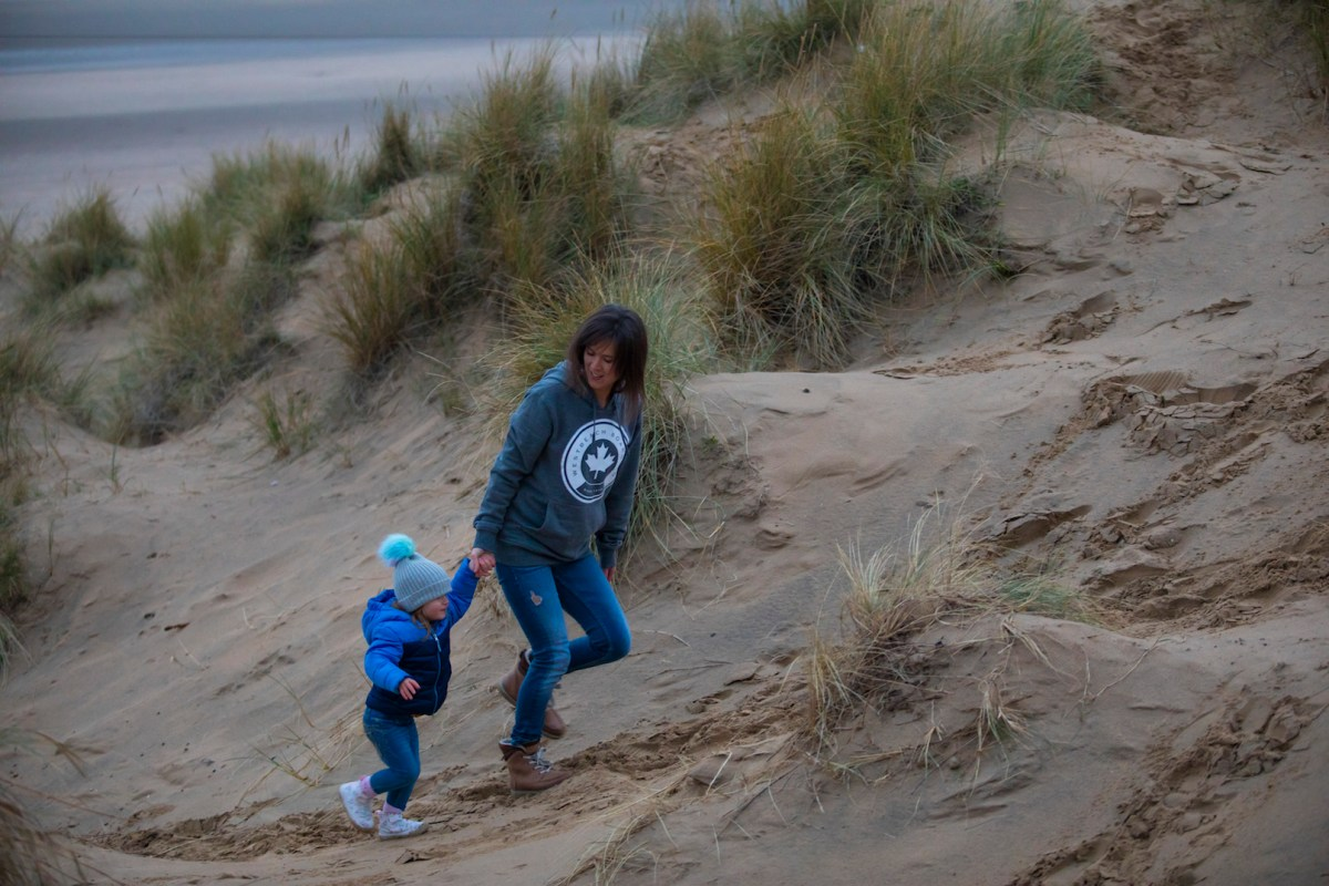 Emily and I running up the sand dunes at Camber Sands