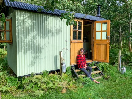 Me sat outside the shepherd's hut on our glamping trip in Dorset.
