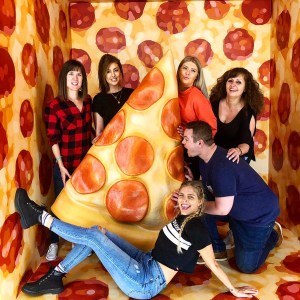 Inside Eye Candy, Toronto with a giant pizza!