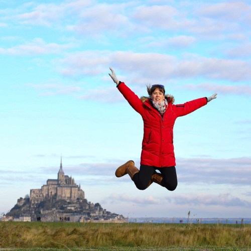 Me jumping in front of Mont Saint Michel