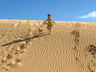 Emily running down the sand dunes, Fuerteventura